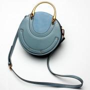 時尚復古金屬手提女包小圓包鉚釘單肩斜挎包小包包潮