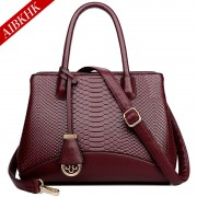 S9206歐美時尚蛇紋手提包真皮女包中年媽媽包
